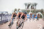 Elite women compete during the bike leg of the 2015…