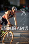 Hunter Kemper competes during the bike leg of the 2015…