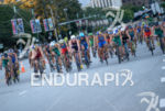 Elite men compete during the scenic bike leg of the…