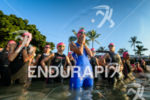 Female age group athletes wait before swimming to the swim…