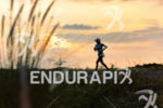 age group athlete before sunset during the run leg at…