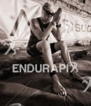 Female agegroup athlete contemplates before swimming to the swim start…