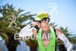 Athlete hydrates himself during the run portion at  the 2015…