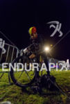 Athlete prepares his bike before the start of the 2015…
