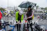 Age group athlete prepares in the rain before the start…