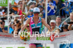 Carrie Lester celebrates at the finish at Challenge Roth in…