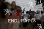 Age groupers head out onto the bike course at the…