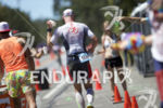 Age groupers head through an aid station during the run…