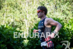 Ben Collins during the run portion of the 2017 Ironman…
