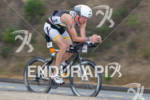 Gavin Anderson on bike at the  Ironman 70.3 California on…