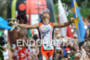 Andi Boecherer crosses the finish line at the…