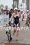 Melanie McQuade enters T2 at the  Ironman 70.3 California on…