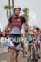 Paul Ambrose exits T1 at the  Ironman 70.3 California on…