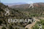 Athletes bike through the scenic canyon at the  Ironman St.…