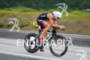Chris Lieto races downhill on the bike at the Ironman…