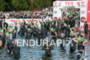 Competitors enter the water at the 2012 Ironman…
