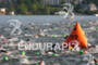 Triathletes swim at the 2012 Ironman Lake Placid…