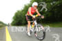 Luke Bell on bike at the 2012 Ironman…