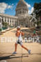 Justin Daerr running through the capitol square during…