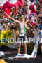 Pete Jacobs stands victorious at the Ironman World…