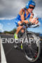 Christian Brader climbs toward Hawi on bike at the Ironman…