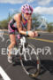 Cait Snow bikes toward Hawi at the Ironman…