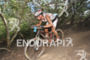 Josiah Middaugh rides through the woods on his…