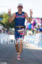 Paul Amey crossing the finish line at the 2012 Ironman…