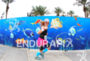 Triathlete running in front of a aquarium cartoon.