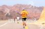 Triathlete running in the Arava Valley in direction…