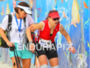Triathlete exhausted during the run helped by a…