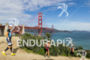 Athletes run past the Golden Gate Bridge at…