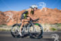 Lesley Patterson climbs on bike through Snow Canyon…