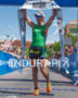 Meredith Kessler at the finish line after winning…
