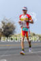 Craig Alexander running at the 2013 Ironman World Championship in…