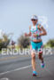 Mirinda Carfrae running at the 2013 Ironman World Championship in…