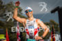 Eneko Llanos crosses the finish line at the Ironman World…