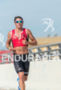 Leon Griffin running at the 2013 Ironman 70.3 Miami in…
