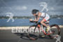 Mirinda Carfrae riding on the bike at the 2014 Ironman…