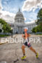 American Daniel Bretscher runs past the Capitol on the way…