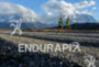 Two athletes running side by side at the 2014 Patagonia…