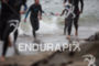 Age group athletes exit the rough swim at the 35th…
