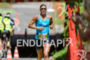 Lisa Huetthaler competes in the run leg during the 2015…