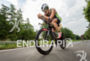 Christian Kramer competes during the bike leg of the Ironman…