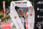 Camilla Pedersen celebrates at the finish line of the Ironman…
