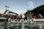 Age group athletes enter the water before swimming to the…