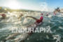 Athletes swim to the swim start at the 2015 Ironman…