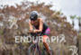 Female athlete during the bike portion of the  2015 Ironman…